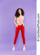 Full length portrait of a smiling young casual woman