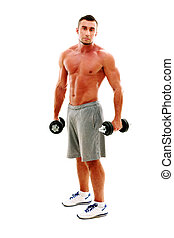 Full length portrait of a sportsman  standing  with dumbbells