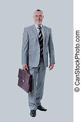 Full length portrait of a successful mature business man.