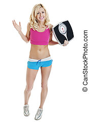 Full length portrait of a woman holding a scale against white