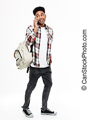 Full length portrait of a young african male student dressed...