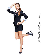 Full length portrait of a young beautiful business woman stand on one leg isolated on white background