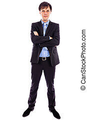 Full length portrait of a young businessman standing with arms folded against white background