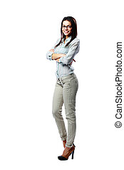 Full-length portrait of a young happy woman with arms folded isolated on white background