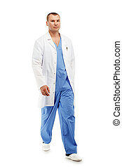 Full length portrait of a young male doctor in a medical surgical blue uniform in motion leaving the operating room