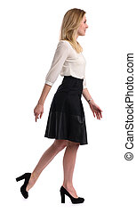 Full length portrait of a young woman walking