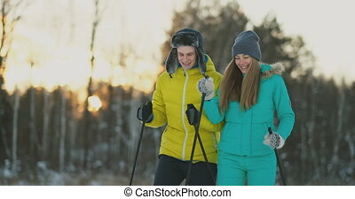 Full length portrait of active young couple enjoying skiing...