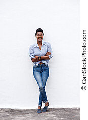 african american woman smiling against white wall
