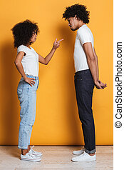 Full length portrait of an angry afro american couple