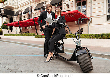 Full length portrait of an attractive couple in smart clothes
