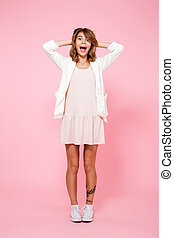 Full length portrait of an excited surprised girl in summer...