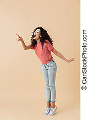 Full length portrait of an excited young woman