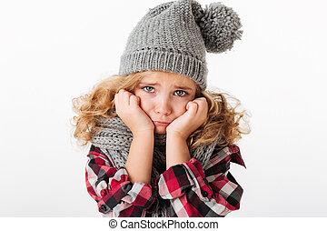 Full length portrait of an upset little girl