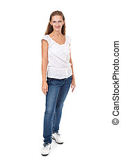 Full length portrait of beautiful casual girl pointing up and looking at camera. Isolated on white background.