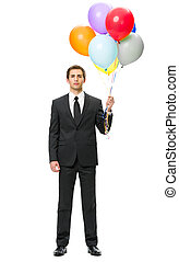 Full-length portrait of business man with balloons