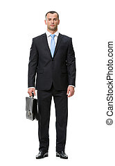 Full-length portrait of business man with case