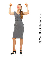 Full length portrait of business woman pointing up