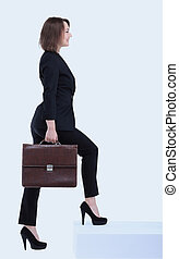 Full length portrait of business woman with briefcase going .