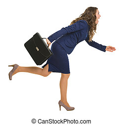 Full length portrait of business woman with briefcase running sideways