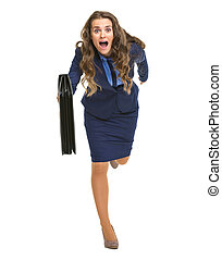 Full length portrait of business woman with briefcase running straight