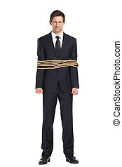 Full-length portrait of businessman tied with the rope