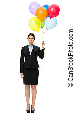 Full-length portrait of businesswoman with balloons