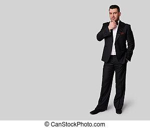 full length portrait of fashion man in tuxedo
