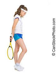 Full length portrait of female tennis player