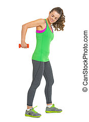 Full length portrait of fitness young woman making exercise with dumbbells
