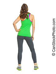 Full length portrait of fitness young woman . rear view