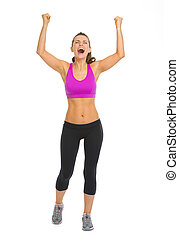 Full length portrait of fitness young woman rejoicing success