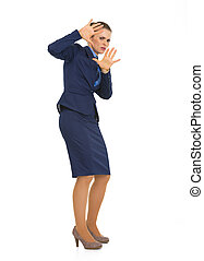 Full length portrait of frightened business woman