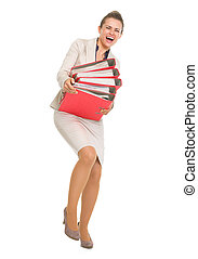 Full length portrait of frustrated business woman with stack of folders