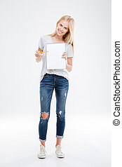 Full length portrait of girl pointing pencil at blank notebook
