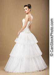 Full Length Portrait of Graceful Bide in White Wedding Dress