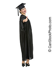 Full length portrait of graduation student woman showing thumbs up. HQ photo. Not