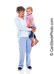 grandmother carrying her grandchild - full length portrait ...