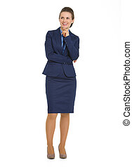 Full length portrait of happy business woman looking on copy space