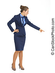 Full length portrait of happy business woman pointing on copy space