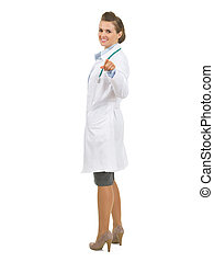 Full length portrait of happy doctor woman pointing in camera