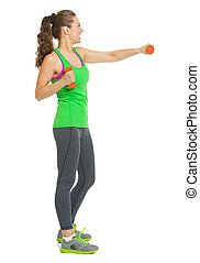 Full length portrait of happy fitness young woman making exercise