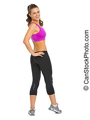 Full length portrait of happy fitness young woman looking out