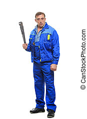 Full length portrait of happy male mechanic in overalls holding wrench over white background.
