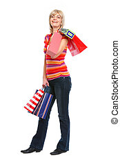 Full length portrait of happy old woman with shopping bags