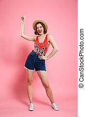 Full length portrait of happy playful woman in summer wear...