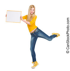 Full length portrait of happy student girl showing blank board