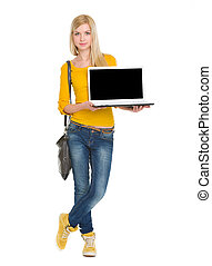 Full length portrait of happy student girl showing laptop