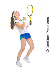 Full length portrait of happy tennis player rejoicing in...