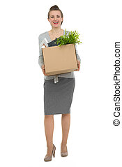 Full length portrait of happy woman employee with box with personal items