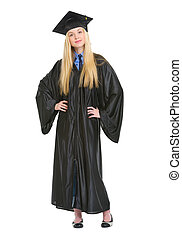 Full length portrait of happy young woman in graduation gown